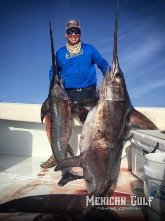 swordfish photo. Two swords with Capt. Billy Wells, MGFC. Venice, LA