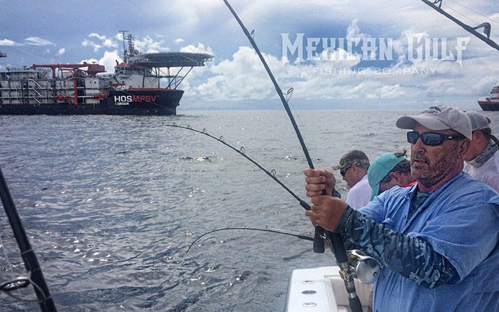 yellowfin tuna three up. Colin Byrd, MGFC photo. July 2016
